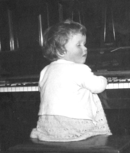 Cherry 'playing' the piano aged eyes closed about 3