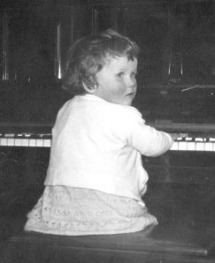 cherry 'playing' the piano aged about 3 eyes open